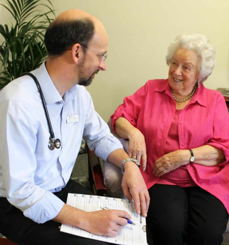 Palliative Care Nurse Practitioner Peter Jenkin consults