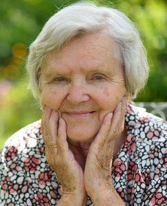 Older woman in garden.