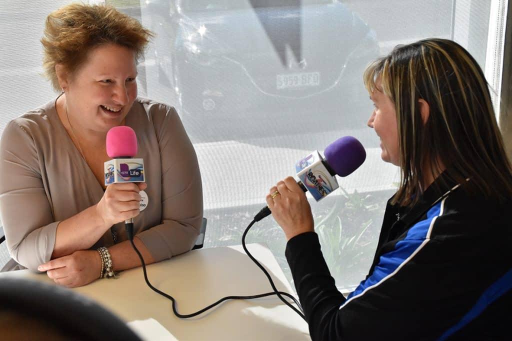 Volunteer chats with Jodie the Roadie