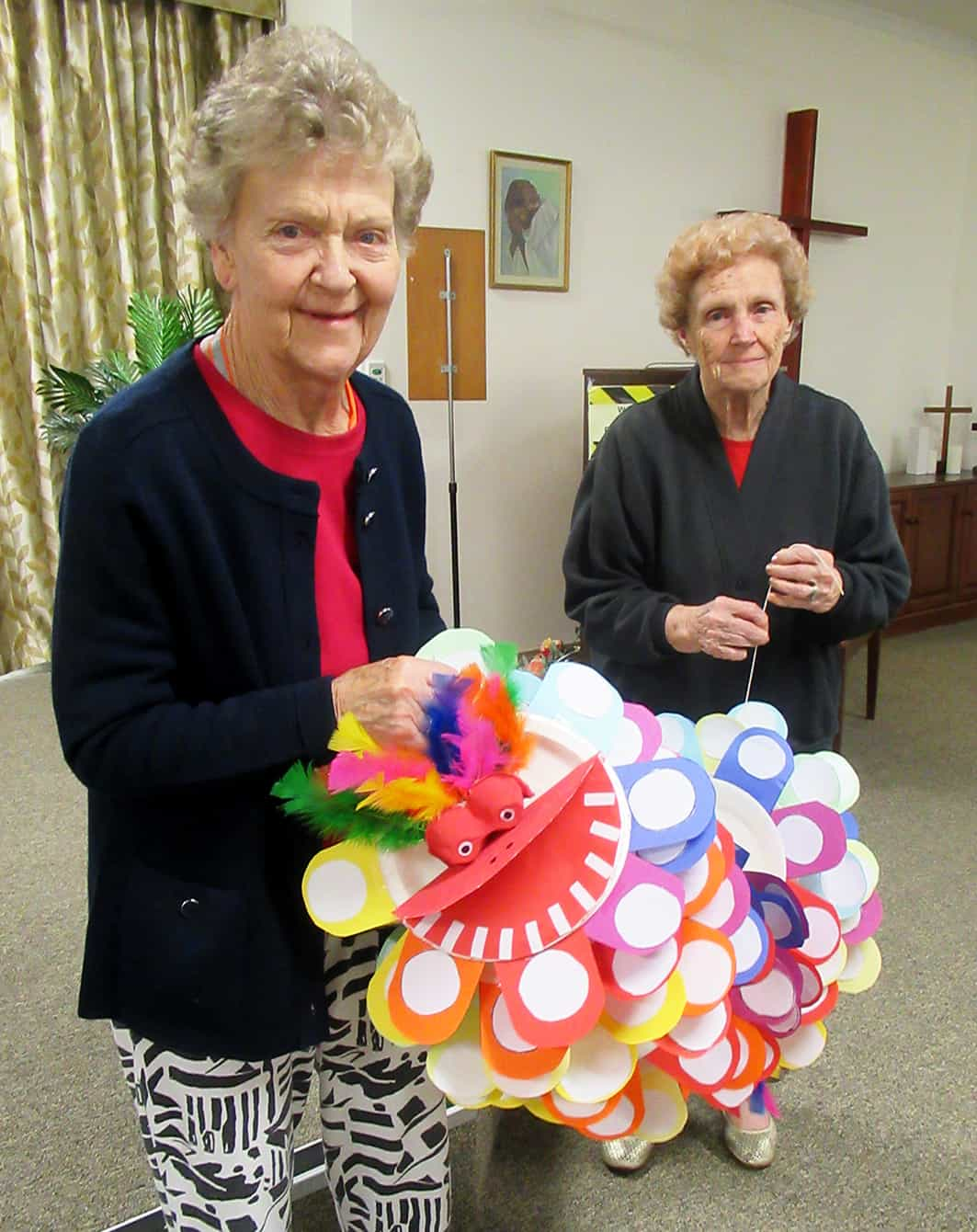Elaine Cotton and Betty Orman with the dragon they made