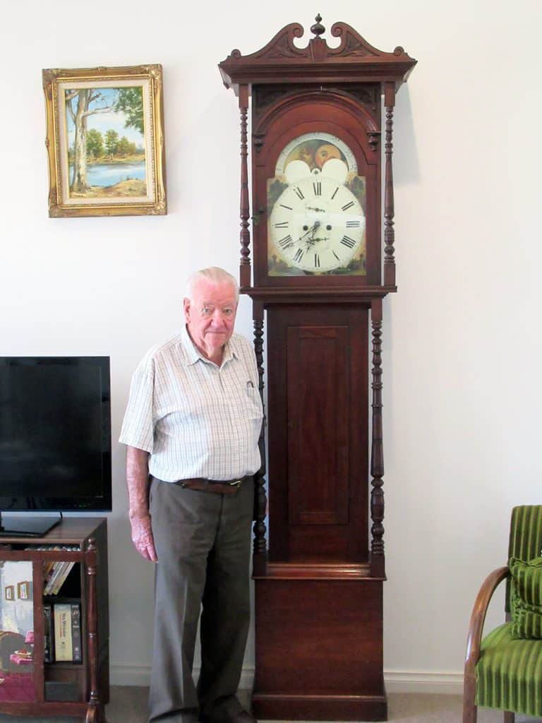 Mr Peter Broadbent with his 170 year old grandfather clock