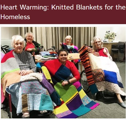 residents of Reshtaven with knitted blankets