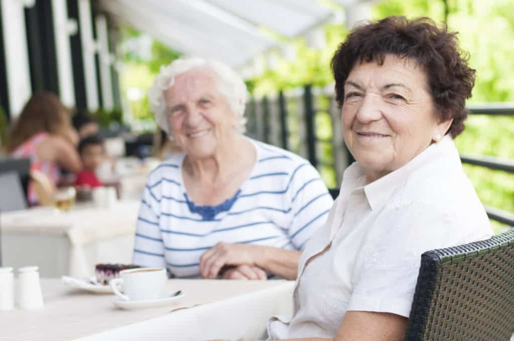 two senior ladies having coffee together
