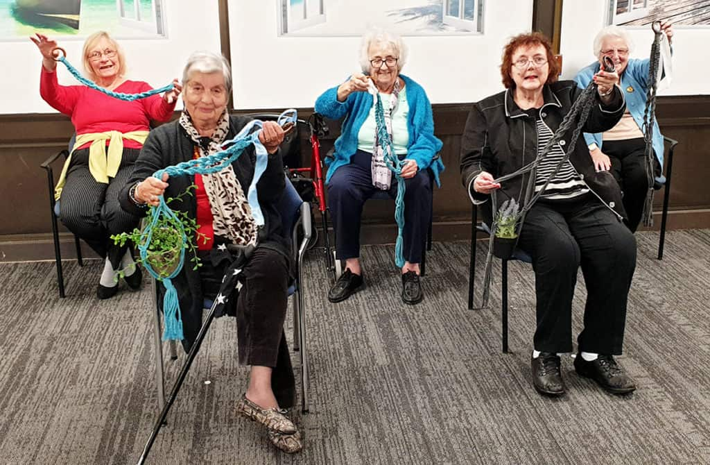 Macramé plant holders created by the craft group at Resthaven Marion Community Services