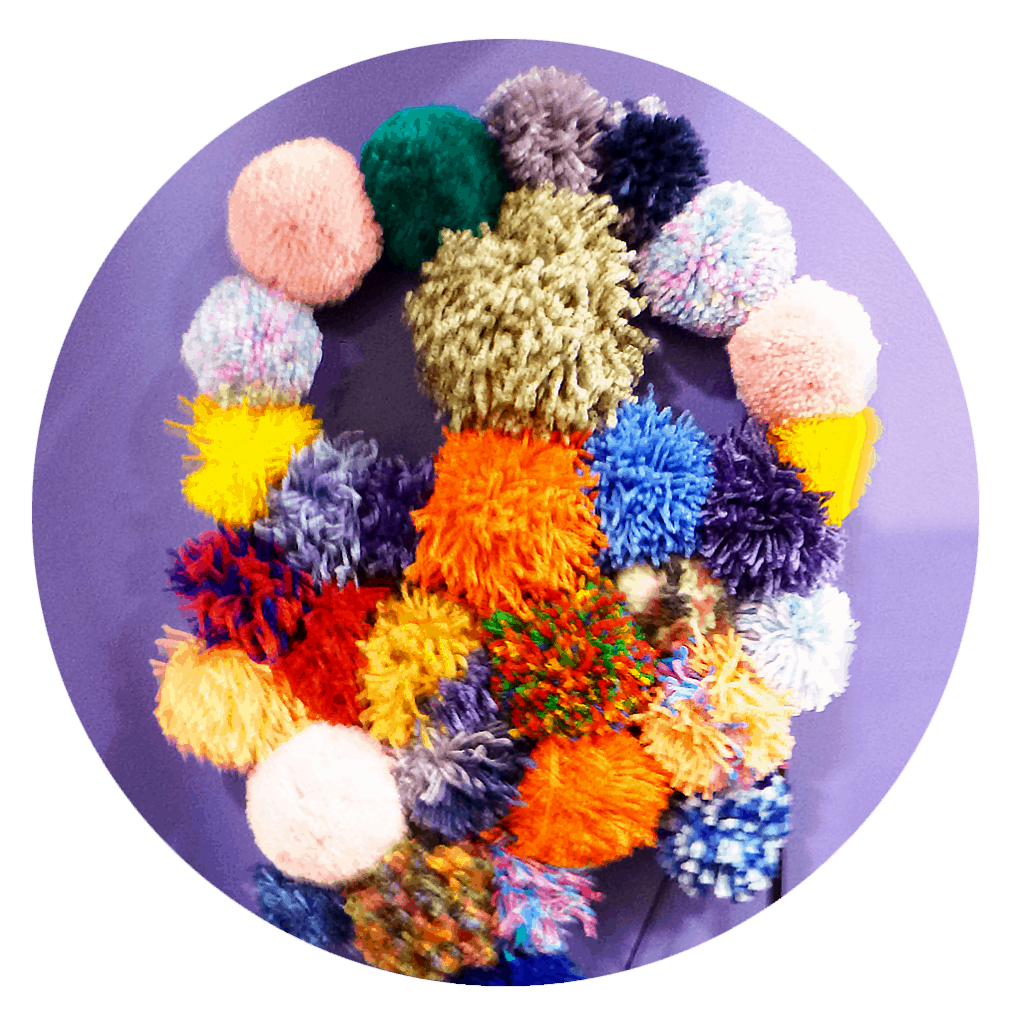 photo of colourful hanging pom poms