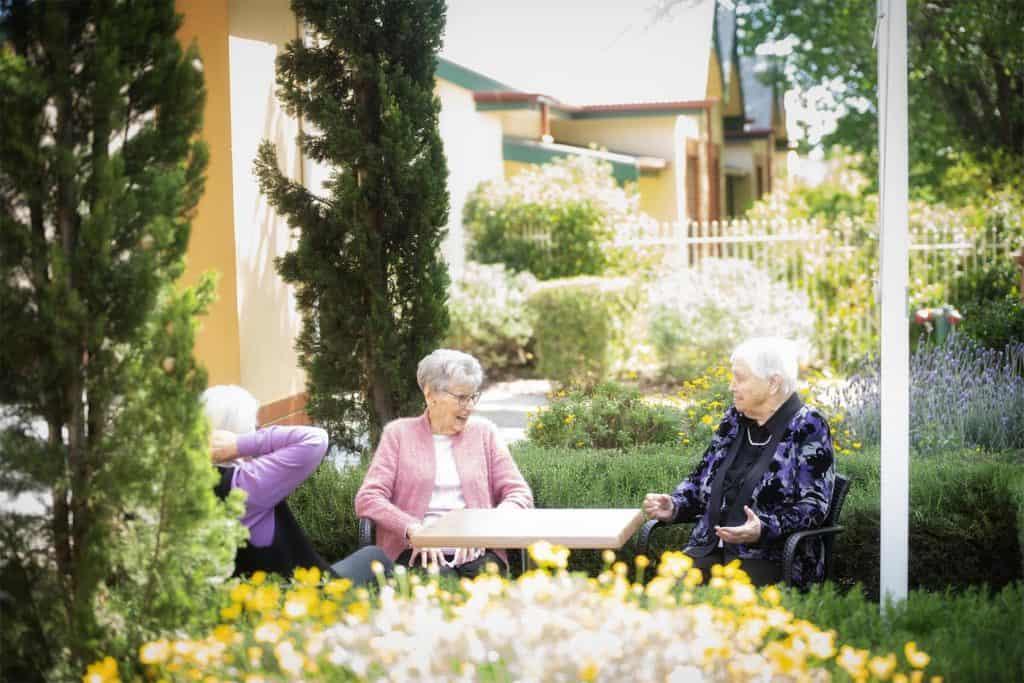 elderly ladies chatting in garden