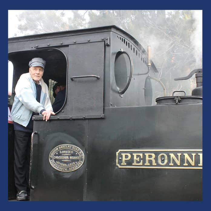 elderly man standing on Peronne train