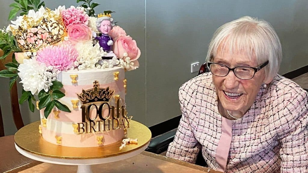 100 year old woman with birthday cake