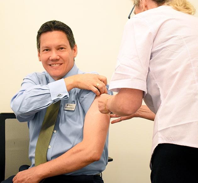 CEO receiving vaccine