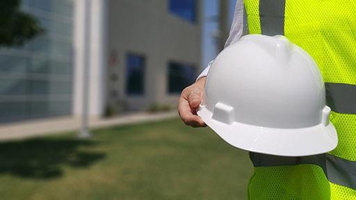 hand holding white helmet