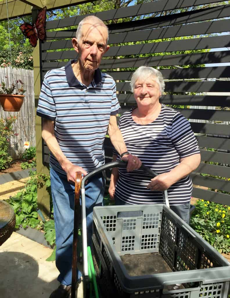 Elderly couple with trolley in a back porch