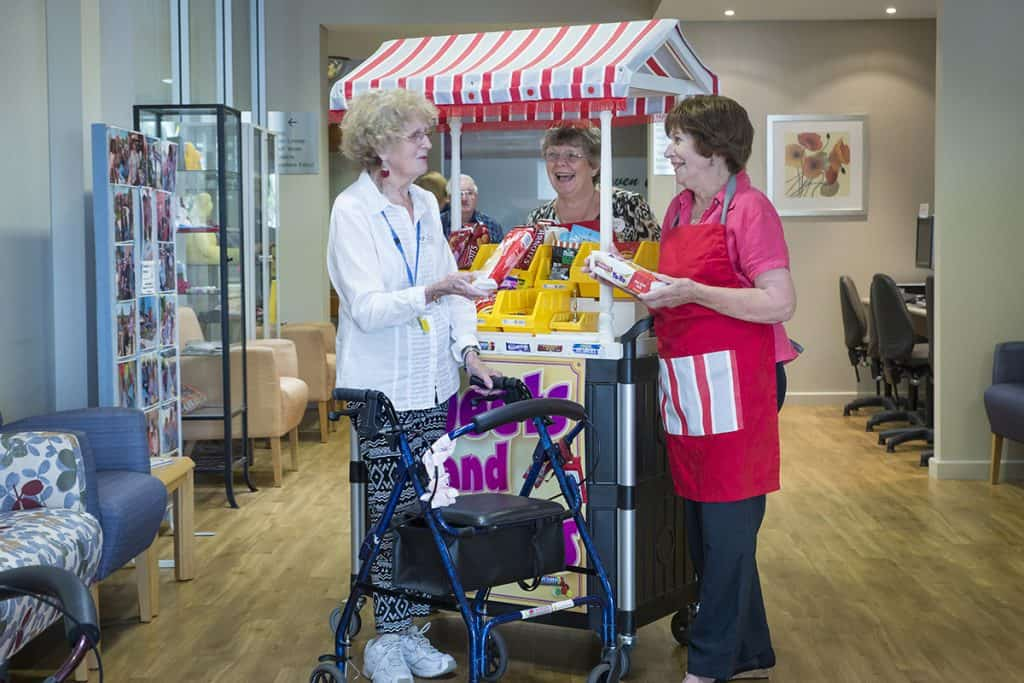 Betty and Volunteers, Di and Judy have a chat at the Resthaven Marion travelling shop